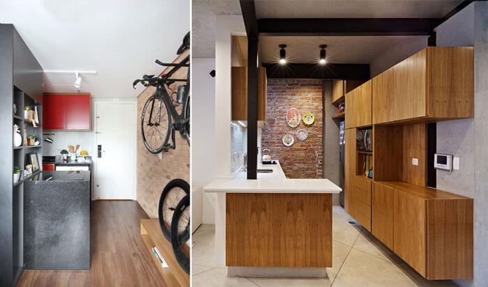 imagem de uma cozinha com revestimento em madeira e parede de tijolos à vista