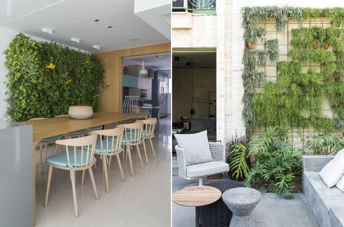 área externa com mesas e cadeiras, ao fundo uma parede com plantas