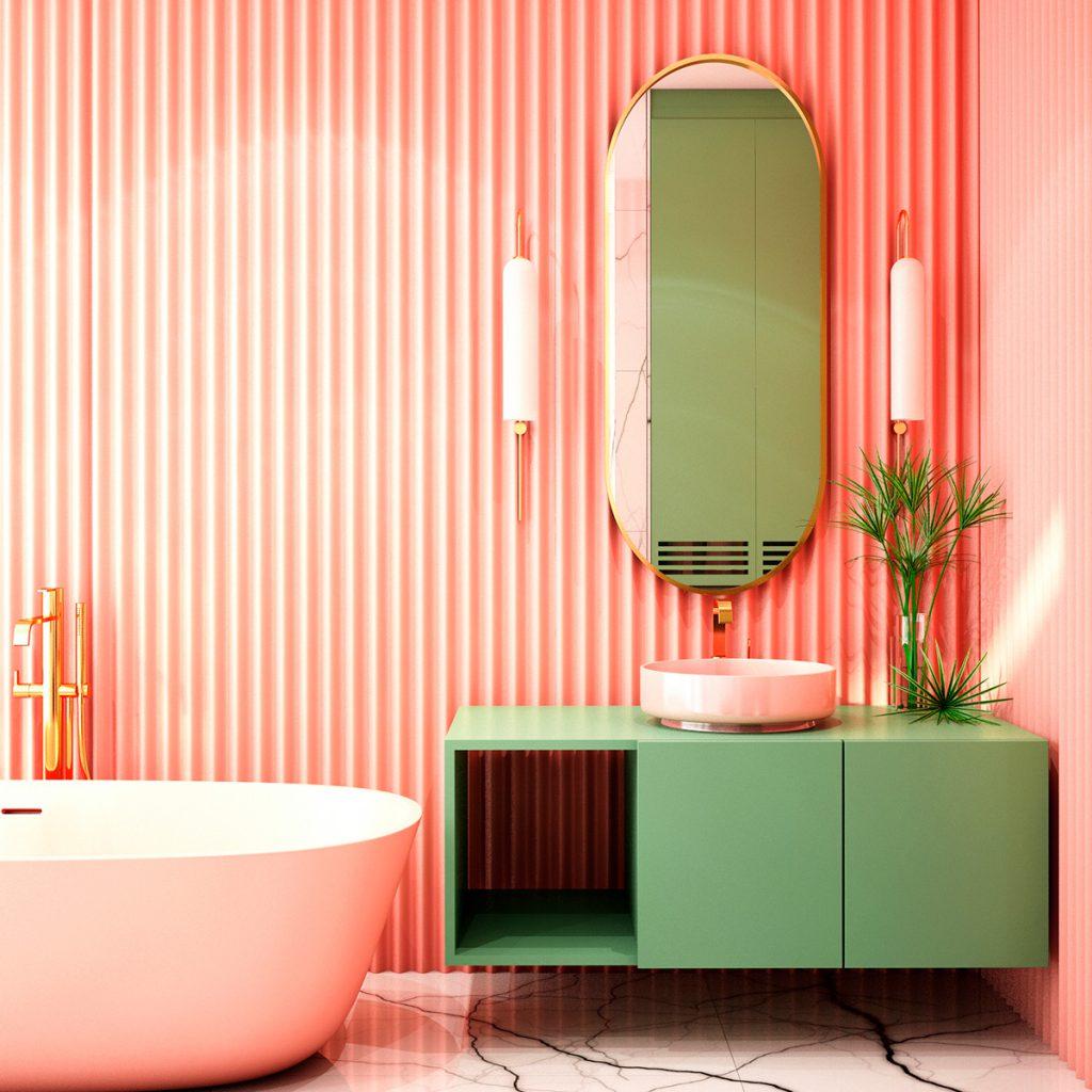 Banheiro com tons na parede coral e   com detalhes dourados